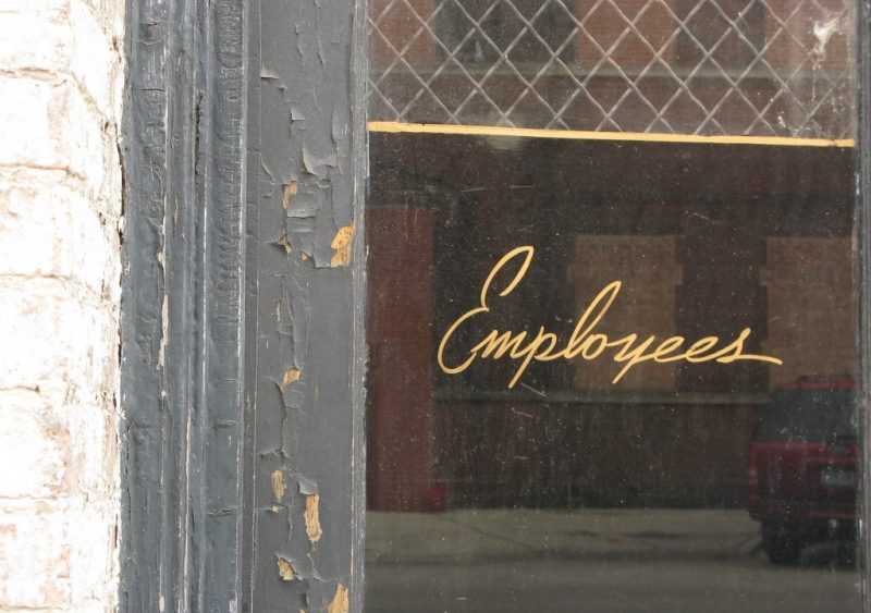 Office window with employee sign