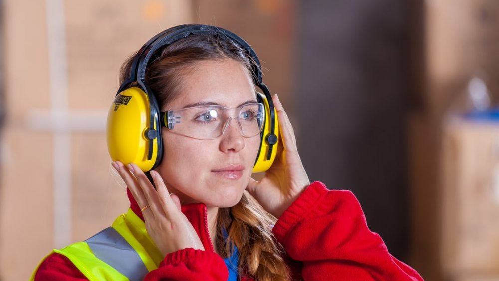 Young woman volunteering in construction position