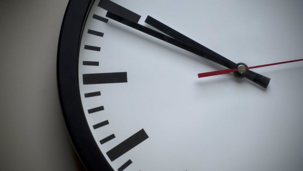Close up picture of a clock on the wall