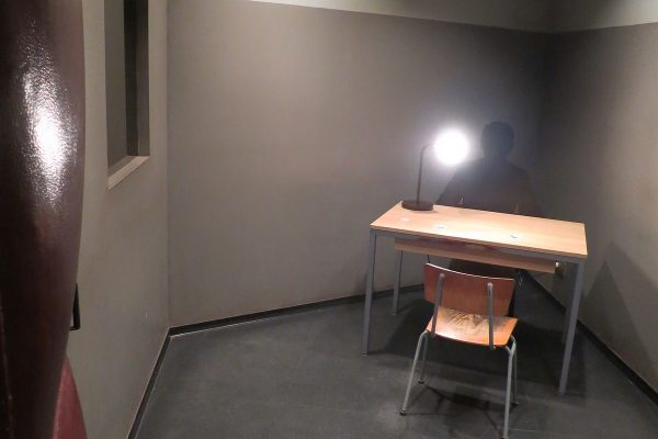 Interrogation room with a table in the corner