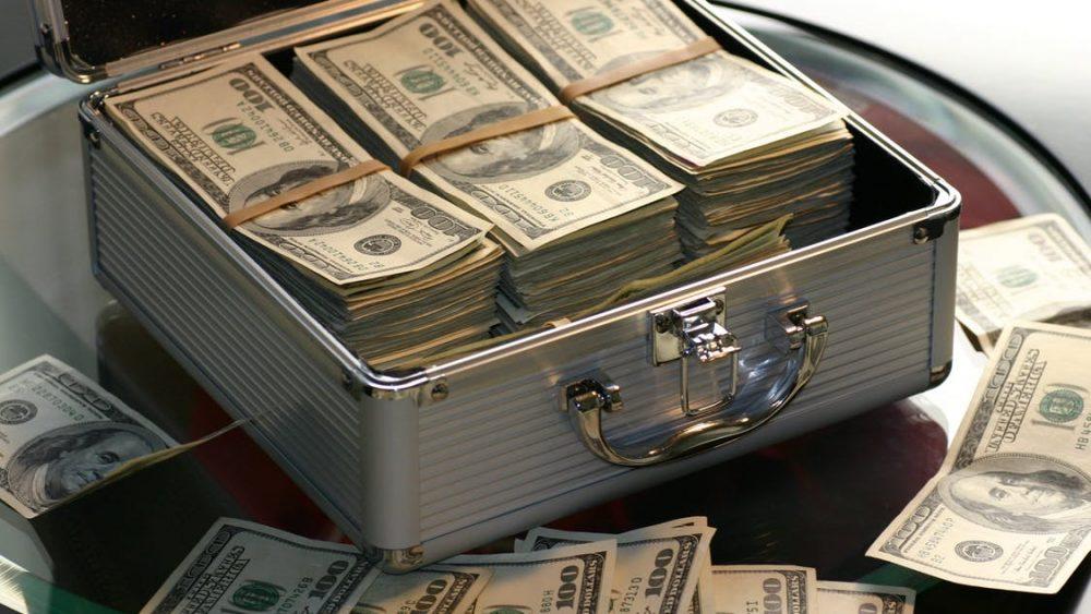Money box full of cash for payroll