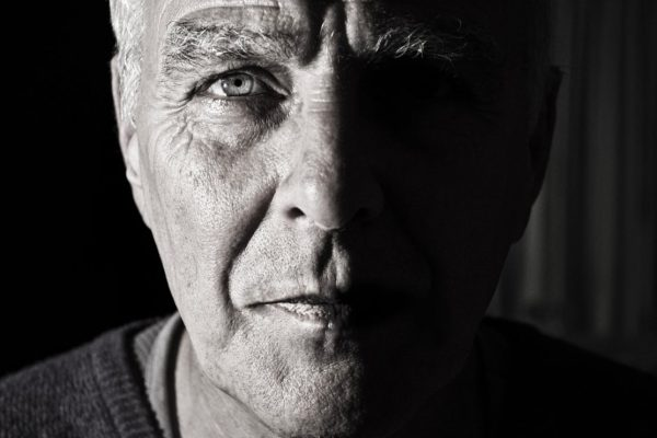 A black and white photo of an older gentleman's face