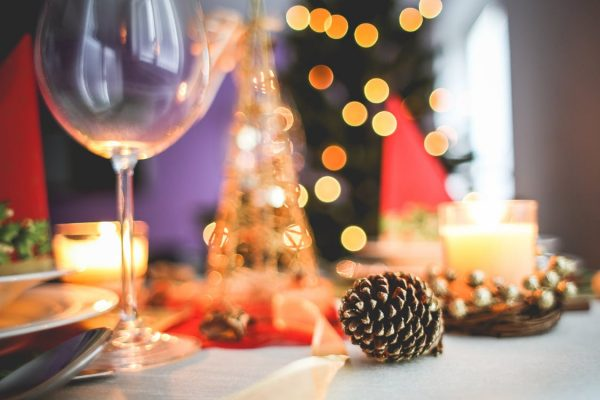 A photo of a wine glass at a holiday party