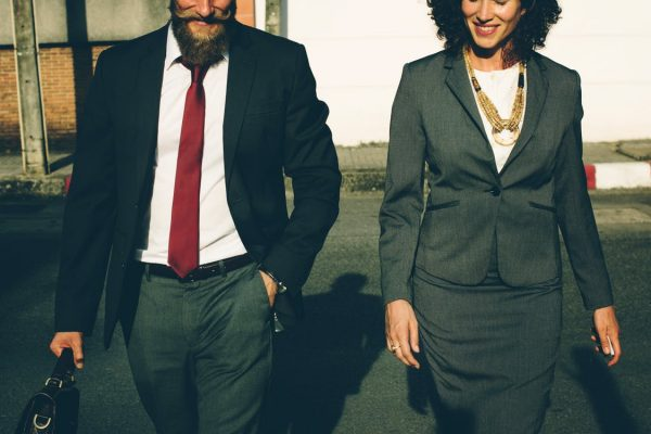 Two employees in suits leaving work for the day