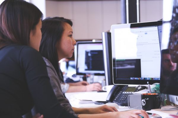 Two women working on a computer