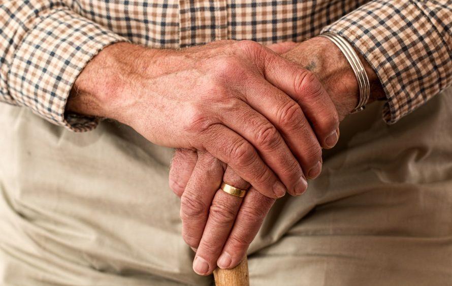 Older gentleman holding a cane