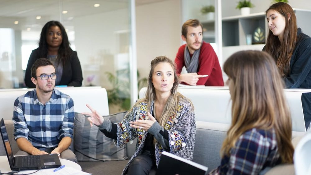 A woman talking to a group of colleagues