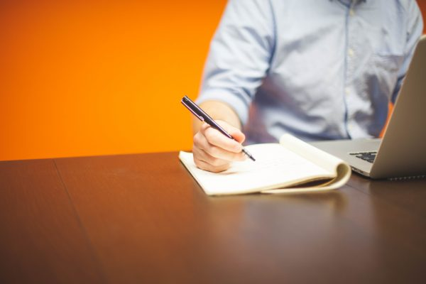Man taking notes to defend company