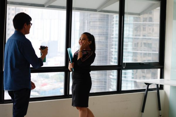 Two employees talking in the office