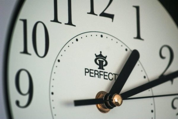 A close up photo of a clock on the wall
