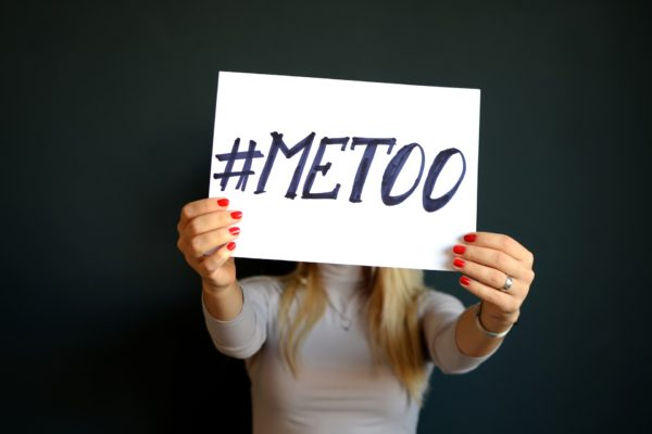 Woman holding #metoo sign