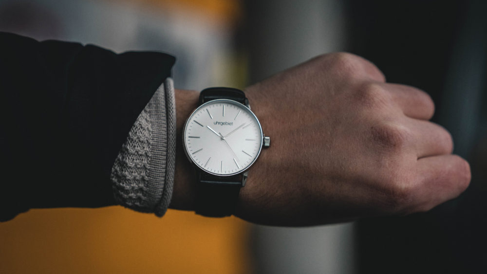 A man's watch implying running out of time.