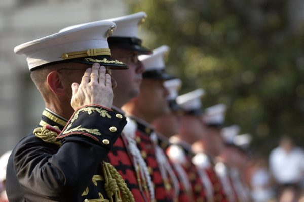 A photo of members of the armed forces saluting