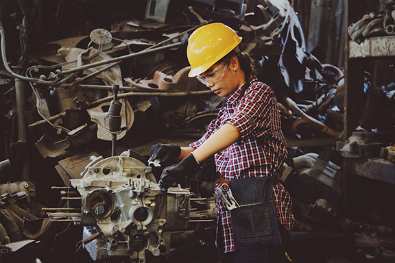 Girl working on a machine in a factory