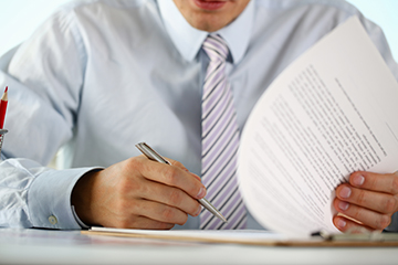 A businessman signing a noncompete document