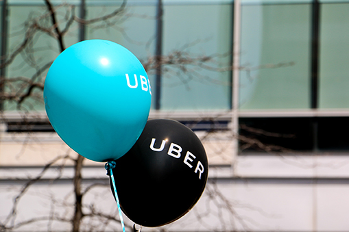 Two balloons with the word UBER on them