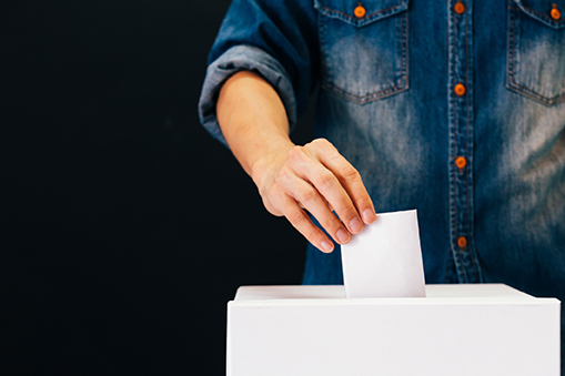 A man casting a vote by ballot